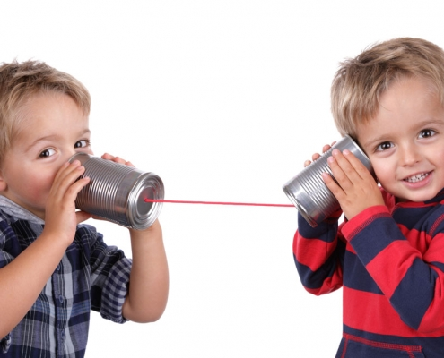 children using tin can phones voip